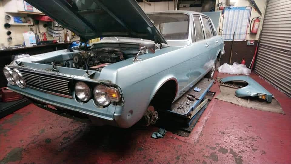 Ford Zodiac front wings being refitted